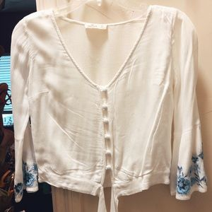 Hollister blouse with floral detail at wrists